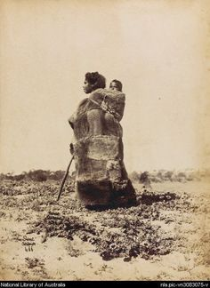 Portrait of unidentified Aboriginal woman wearing a possum skin cloak, carrying a child on her back, South Australia, ca. National Library of Australia. Aboriginal Culture, Aboriginal Artists, Aboriginal People, Aboriginal Education, Indigenous Education, We Are The World, People Of The World, Australian Aboriginal History, Australian Aboriginals