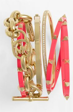I love the mix of gold bangles and bright coral!