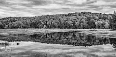 Algonquin 3 Bw.  Highway 60, the lone route across the vast wilderness of Ontario's Algonquin Provincial Park, offers one of the world's most spectacular autumn drives. The vibrant sugar maples dominate in this section at Park Lake. The adventurous can choose from dozens of canoe and backpacking routes and travel for hundreds of miles through pristine lakes, rivers and mountains.