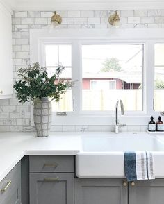 Perfect white quartz kitchen countertop, and perfect colouring for my backsplash. Kitchen Redo, Kitchen Backsplash, New Kitchen, Kitchen Dining, Marble Tile Backsplash, Kitchen Cabinets, Grey Cabinets, Kitchen Counters, Subway Tiles