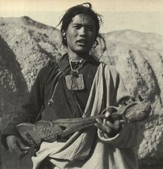 Village youth playing a guitar(sgra-snyan). An amulet hangs round his neck. David Snellgrove & Hugh RichardsonA Cultural History of Tibet