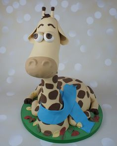 Melman the Giraffe, shaped cake. All edible! the neck is rice crispie treats (rice crispies and marshmallow blend)