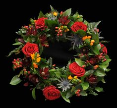 Funeral, sympathy wreath. Red roses and orange
