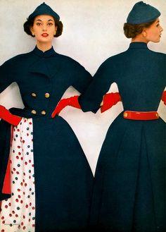 1952 Barbara Mullen in silk surah print dress worn under a Forstmann wool military style coat by Hattie Carnegie, Harper's Bazaar