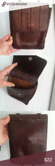Vintage cross body brown leather purse Vintage brown genuine leather cross body small purse has been used so has wear marks and scuffs but in good condition. Made in Brazil made in brasil Bags Crossbody Bags