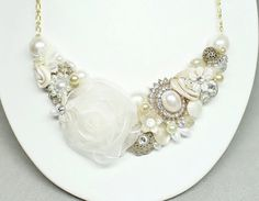 Hey, I found this really awesome Etsy listing at https://www.etsy.com/listing/172274065/ivory-bridal-necklace-floral-wedding