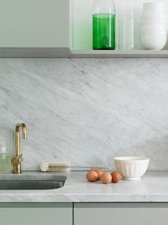 The hardware.  COCOCOZY: MINT & MARBLE - HOW TO MAKE A SMALL MODERN KITCHEN WORK!