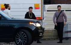 Banter: The One Direction star appeared to be in a good mood as he idled outside with two ...