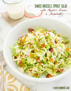 Shaved Brussels Sprout Salad with Apples, Bacon, and Hazelnuts is a fresh, crunchy salad tossed in a creamy maple dressing. It's fall's finest!