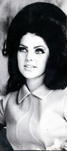 I tried to learn about eye liner and lots of it from Twiggy & Priscilla Presley.  She had some amazing hair!