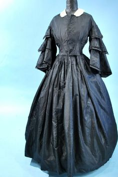 Mourning Dress: circa early 1860s, silk with three-tiered pointed pagoda sleeves trimmed in velvet.