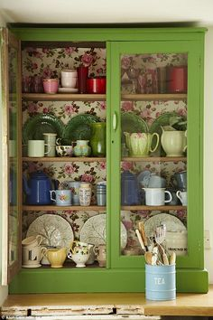 The freestanding kitchen cabinet displaying treasures old and new was from a car boot sale; try Goose Home & Garden (goosehomeandgarden. com) for similar.