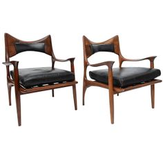 Phillip Lloyd Powell; Carved Walnut and Leather Lounge Chairs, 1960.