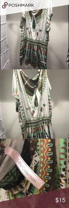 Flowy tribal top This top has tribal print and has an elastic band under the breast to make it look reallly flowy. Super cute with leggings or jeans and cowgirl boots Tops Tees - Short Sleeve