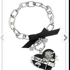 GUESS Bracelet, Jet and Crystal Heart Charm Toggle Bracelet. Really don't like branded stuff, but this is cute. Rock N' Roll Outfits, Sunglasses Accessories, Jewelry Accessories, Maxi Collar, Guess Girl, Guess Purses, Jewelry Tattoo, Funky Jewelry, Fashion Videos