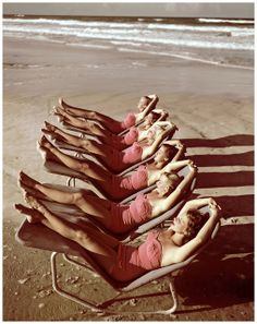 A group of southern belle models sunbathe on the beach at Cypress Gardens theme park in 1953 near Winterhaven, Florida.