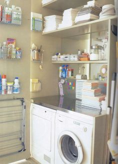 Laundry storage ideas. Wall mounted Wire racks, magnetic backsplash, hooks to hand clothes airer, shelving