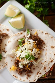 Make tacos in your crockpot and stock your freezer with bags of cooked ground beef for easy dinners!  // she slow-cooked several pounds of meat at once, then sectioned off into smaller freezer baggies for quick taco nights.
