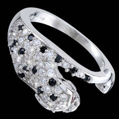 Silver ring, zirconia, puma Silver ring, zirconia, Ag 925/1000 - sterling silver. Attacking puma creates withe and black zirconia, predator eyes creates red zirconia. Perfect beauty of the beast is vivid. Rhodium-plated. Width at the place of pattern approx. 9mm.