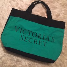 Victoria's Secret Colorblock Tote NWT VS colorblock tote. Teal green, and blue on opposite side. Black detail and black lettering. Heavy duty material, very durable. Does not zip or button close on top. Victoria's Secret Bags Totes