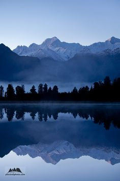 Lake Matheson, South Island - it's the most photographed lake in NZ and from this photo it's not hard to see why!  http://www.travelnation.co.uk/west-coast-glaciers