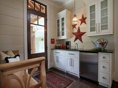 mudroom laundry room combo | Rustic Kitchen by Splash Kitchens & Baths LLC