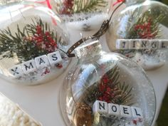 Nothing says I love you like homemade Christmas ornaments! Here is 75 ways to fill clear glass ornaments for homemade Christmas Ornaments! Clear Christmas Ornaments, Clear Glass Ornaments, Noel Christmas, Christmas Decorations, Snowflake Ornaments, Origami Christmas, Tree Decorations, Snowflakes, Clear Baubles Ideas