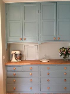 An inspirational image from Farrow and Ball. Cupboards painted in Mizzle and Oval Room Blue.
