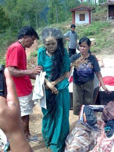 The Walking Dead of Toraja, Indonesia -- Actually, this person is already dead.  The locals take the bodies out to care for them periodically.