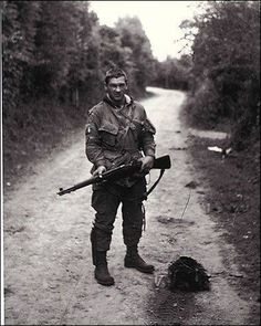 Forrest Guth (1921 2009) One of the original 140 men who trained under Sobel at Camp Toccoa. Guth had the ability to repair and modify weapons. For instance he could make an M-1 rifle fully automatic.He became the armorer for his comrades.Guth's uniform was also unique Guth sew on it many extra pockets. Guth fought in D-Day the Netherlands and the Battle of Bulge.