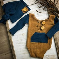 Newborn boy romper set READY TO SHIP!! Adorable mustard and teal color scheme with rustic detail. Darling real wooden buttons complete the woodland feel. Set includes sleepy cap and romper. Fits true to size- NB 6-8 pounds Please note** I design each of my rompers with as much 4-way