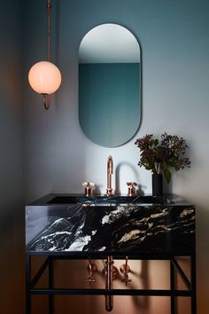 Modern art deco style mirror in bathroom with black marble vanity and sink. Ultra modern and chic Oval Mirror Bathroom, Luxury Bathroom Master Baths, Interior, Bathroom Trends, Oval Mirror, Home Decor, House Interior, Interior Design, Beautiful Bathrooms