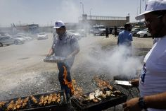 Activists hold food party outside Ofer military prison, north of Jerusalem, where prisoners have joined a hunger strike in protest at conditions