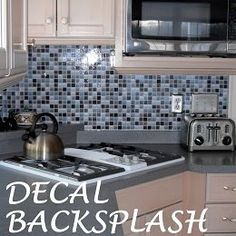the backsplash is a decal-http://dalidecals.com/Modern-Mosaics-Square-Mosaic-Tile-Wall-Decals.html#