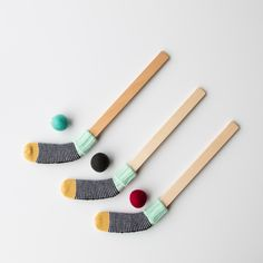 Fun & Stylish Handmade Wooden Toy Hockey Sticks & Pom Pom. A colourful hockey stick to amuse the little sports. Here's a fun way to play hockey, and lets have fun inside without breaking anything. Knitted and manufactured with care in Montreal. So cute!