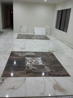 Bookmatched Marble floor tiles in the living and dining area, feature floor
