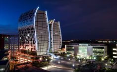 Located at the western edge of the bustling Sandton Central area, the glass and aluminium towers of 15 Alice Lane rise as statuesque architectural. Contemporary Architecture, Interior Architecture, Interior Design, Norton Rose, Africa Continent, Glass And Aluminium, Unique Buildings, Office Buildings, Out Of Africa