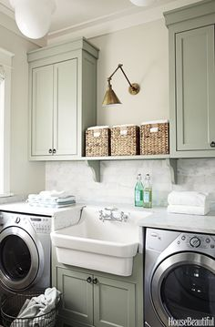 The World's Most Beautiful Laundry Rooms - love the cabinet, wall and molding colour