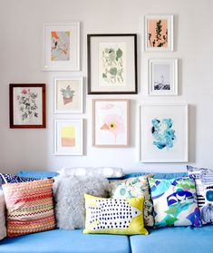 Colorful gallery wall | Colorful Living Rooms