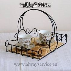 Serving tray with handle Handmade wrought iron, powder coating. Color - black mat. Dimensions 35x25x25 cm. Weight 0.10 kg.