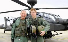 21 March 2011: Prince Charles stands with his son Prince Harry in front of an Apache helicopter at Army Air Corps Middle Wallop  Picture: REUTERS/Richard Dawson/MoD/Crown Copyright