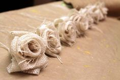 Tutorial on how to make burlap flowers, lots of pictures and multiple types of flowers.