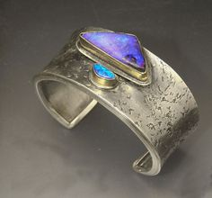 Here two Boulder Opals play off each other on a textured silver cuff. Each opal is set in gold and the contrast between the yummy blue, bri. Opal Jewelry, Turquoise Jewelry, Jewelry Art, Jewelry Bracelets, Silver Jewelry, Fine Jewelry, Jewelry Design, Indian Jewelry, Diamond Jewelry