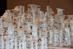 Title: Bravais Lattice, installation  800 porcelin sculptures 5 ft by 5ft  2015 By Angela Broadbent  www.angelabroadbent.com
