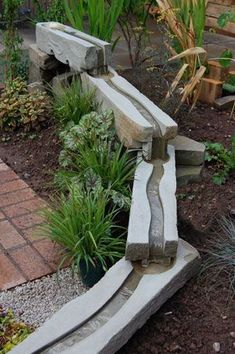 In addition to the water feature pictured above, just one of these water troughs could make an artistic base for rain gutter downspouts. You could cast these in cement or hypertufa. www.ContainerWaterGardens.net