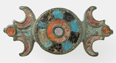 Brooch  Date:     1st-2nd century (?) Culture:     Roman Medium:     Champlevé enamel, bronze - The Metropolitan Museum of Art.
