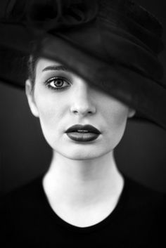 I love the shallow depth of field in this image, as well as the striking black and white contrast. The tilt of the hat covering a corner of the face creating a nice diagonal line is also something I'm drawn to.