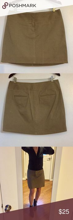 """Kenneth Cole Reaction Tan Twill Skirt Kenneth Cole Reaction Tan Twill Skirt, Material: 94% cotton, 6% spandex, front zipper with 2-hook top closure, Measurements across: waist 16"""", hem 20 1/2"""", length at back 16 3/4"""", excellent condition. * Please note this is a size 8 and I am a size 4/6, but I wanted to model it for you all, so know that it would look even better on the right size person! Kenneth Cole Reaction Skirts Mini"""