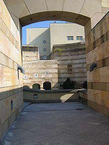"Neue Staatsgalerie - 1984 James Stirling, People walk through the ""external"" rotunda"