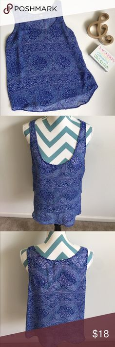 Old Navy Top Like new blue sleeveless top. It is sheer and super breezy. Made with 10% polyester. Looser fit. Great with a white tank underneath. No flaws to note. Old Navy Tops